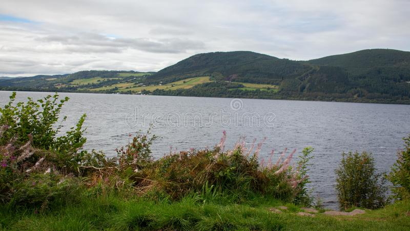 Loch Ness Loch in Scotland. Loch Ness is a large, deep, freshwater loch in the Scottish Highlands extending for approximately 37 kilometres southwest of royalty free stock images