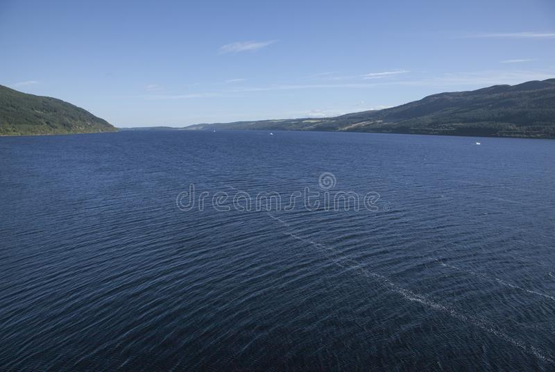 Loch Ness, Scotland - sunny day in summer. Loch Ness is a large, deep, freshwater loch in the Scottish Highlands extending for approximately 37 kilometres stock photos
