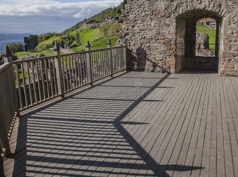 Loch Ness, Scotland - sunny day in summer, Urquhart Castle ruins. Loch Ness is a large, deep, freshwater loch in the Scottish Highlands extending for stock photos