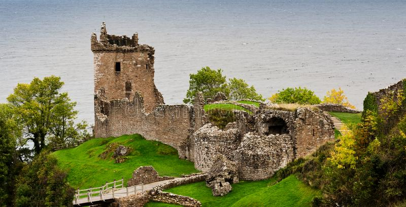 Loch Ness Urquhart Castle. In the centre of the elongated Loch Ness, stands a castle ruin that is the most visited rural attraction in Scotland. Home for a royalty free stock images