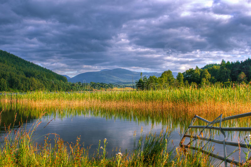 Loch Pityoulish with a beautiful view to the Cairngorms stock image