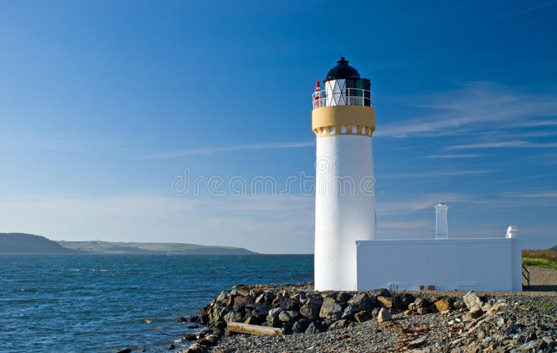 Loch ryan lighthouse. Roch ryan lighthouse also knowen as cairn point lighthouse in cairnryan scotland stock images