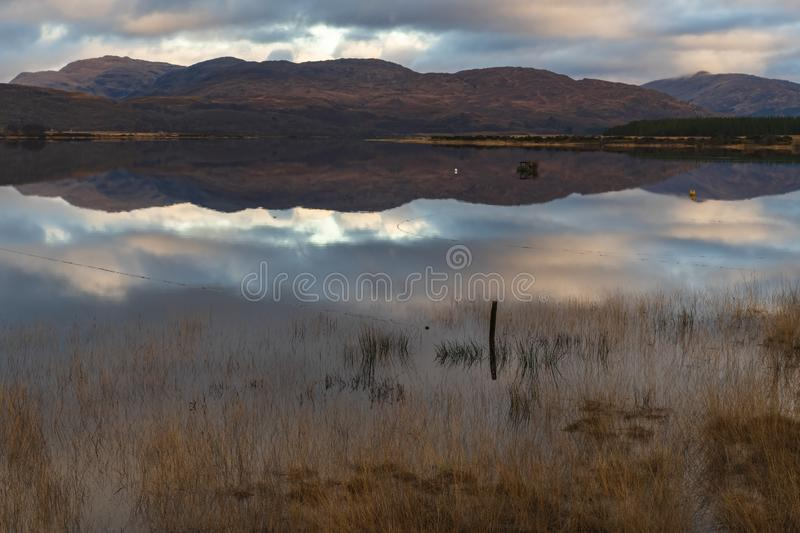 Loch Sheil. Still, morning reflections in Loch Sheil in Argyll and Bute, Scotland stock images