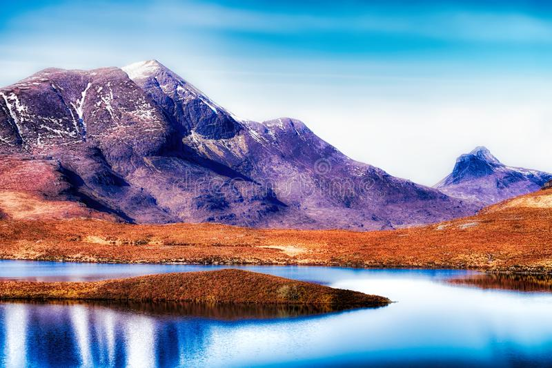 Lochan an Ais, Cul Beag, and Stac Pollaidh. With reflections on the calm waters of the loch stock photography
