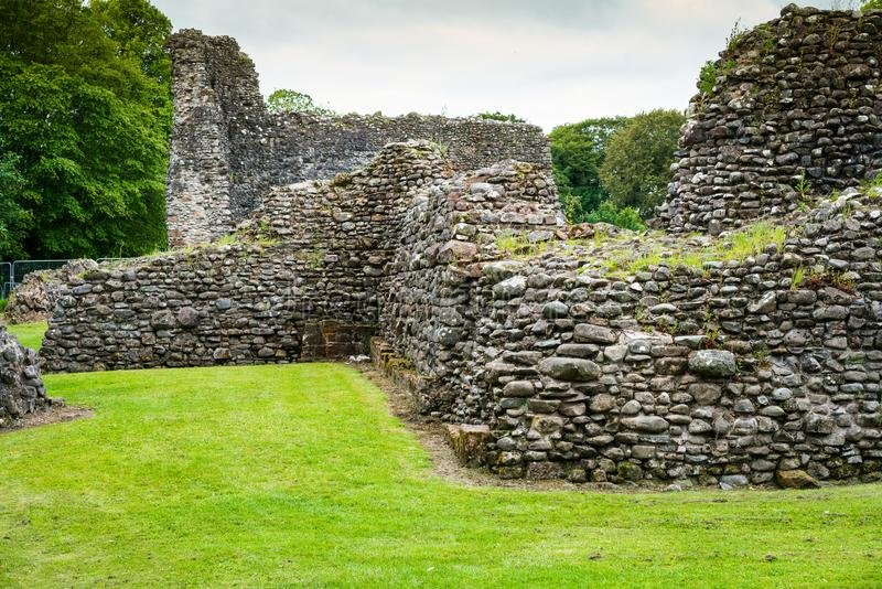 Lochmaben castle ruins and moat. Lochmaben Castle near Lochmaben in Dumfries and Galloway, south west Scotland. The castle is associated with Robert the Bruce stock photos