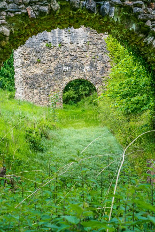 Lochmaben castle ruins and moat. Lochmaben Castle near Lochmaben in Dumfries and Galloway, south west Scotland. The castle is associated with Robert the Bruce stock photography