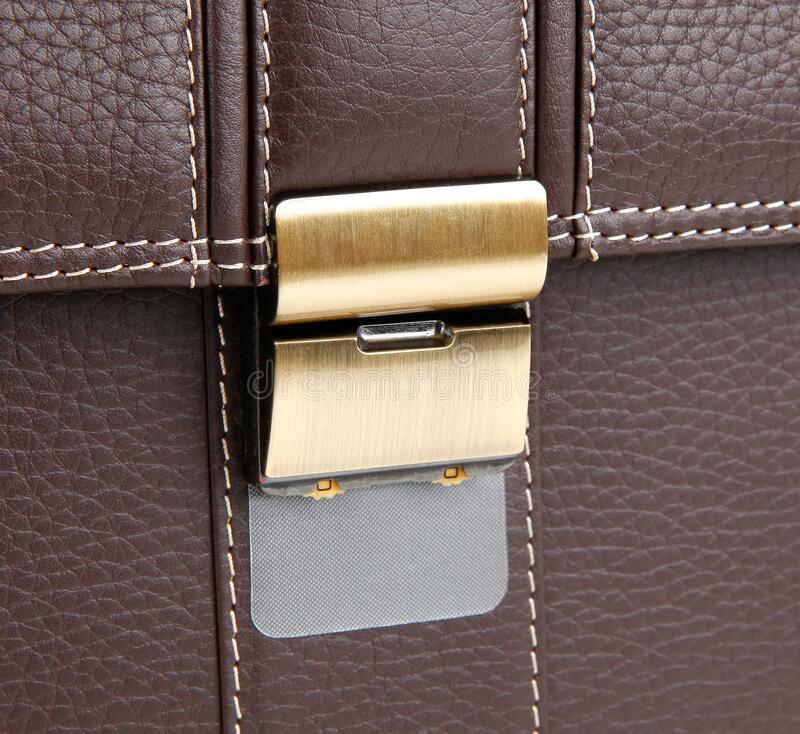 The lock of leather briefcase with code. The lock of brown leather briefcase with code stock photography