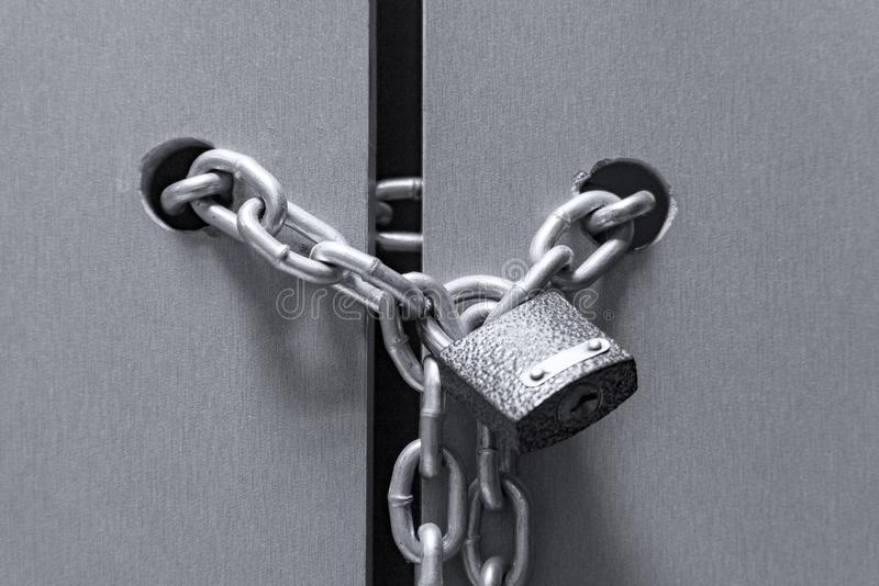 Lock with a chain on the door royalty free stock image