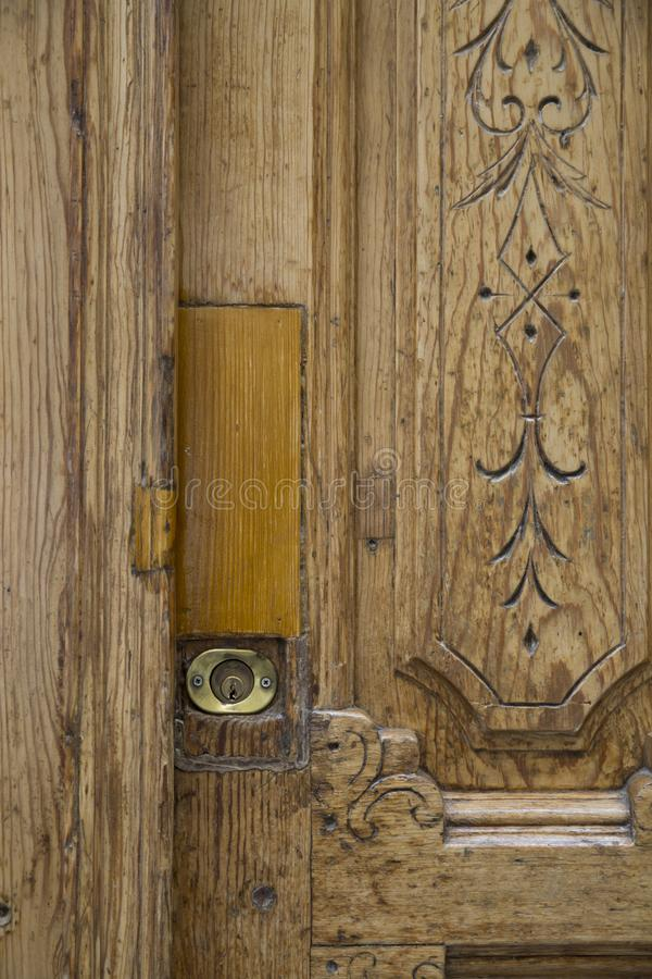 Lock door. Old sculpted door. You can see the lock in the image royalty free stock image