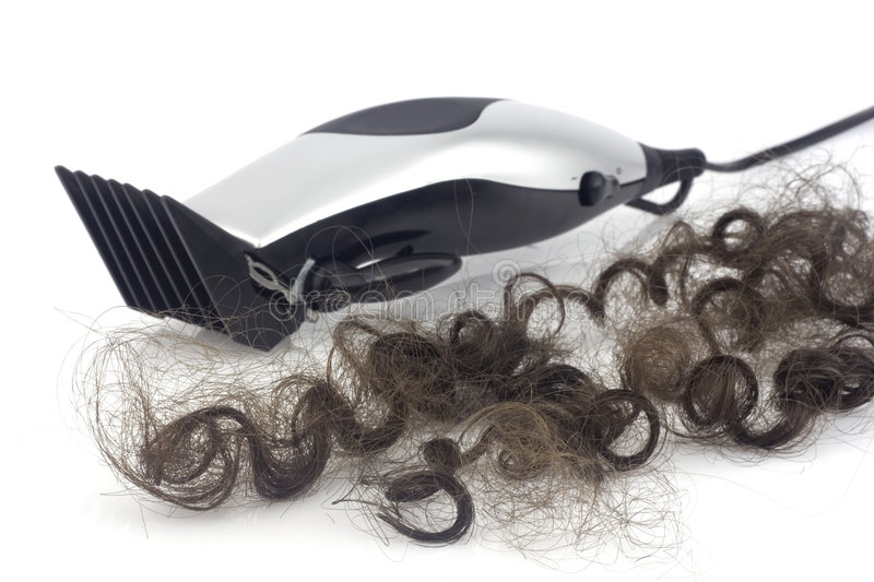 Lock of hair with clipper royalty free stock images