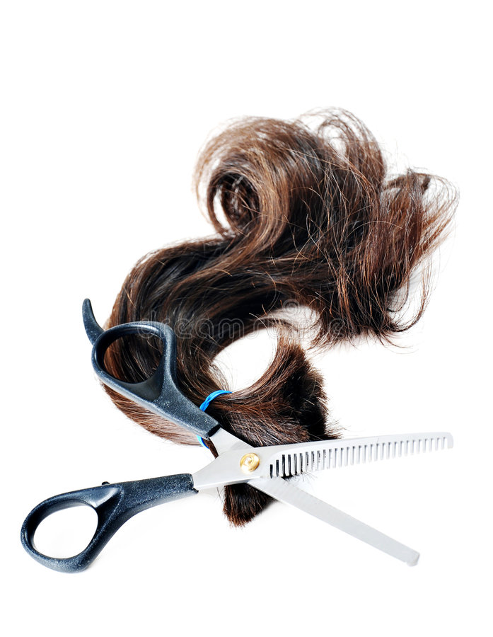 Lock of hair and shears royalty free stock photo