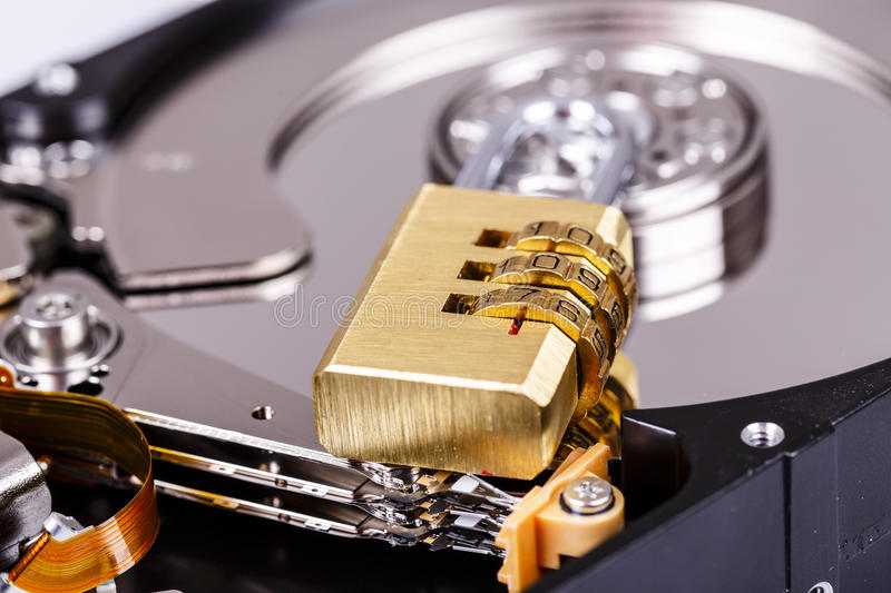 Lock on hdd or harddrive, part of computer, cyber security concept. Data privacy stock images