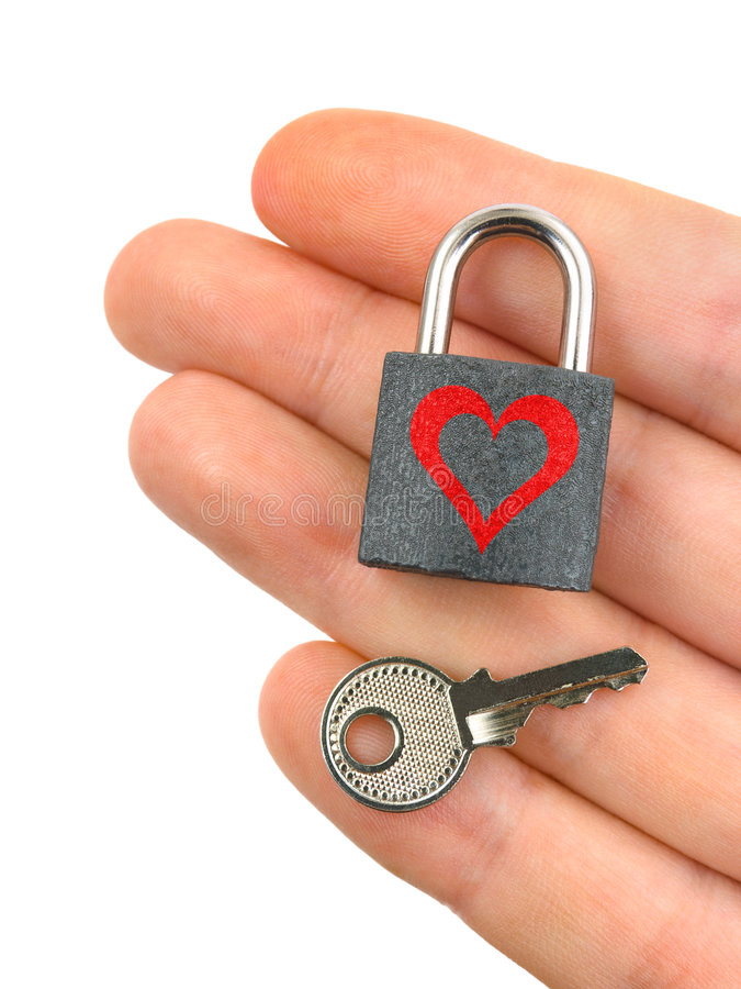 Lock with heart and key in hand royalty free stock image