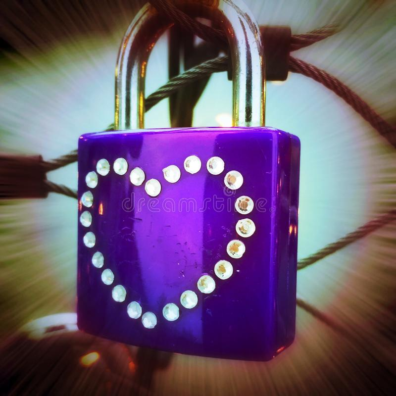 Lock with heart symbol stock images