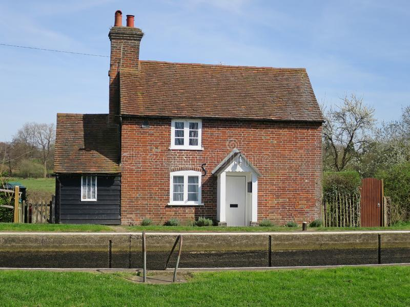 Lock-keeper`s cottage at Triggs Lock. On the River Wey Navigation near Woking, Surrey, England royalty free stock photos