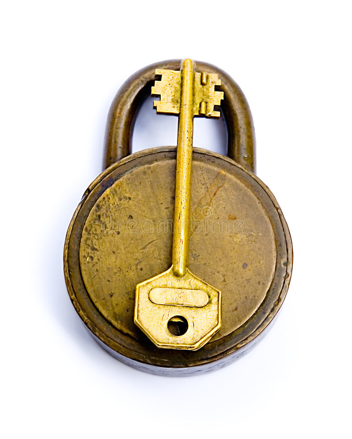 The Lock And The Key Isolated Over White royalty free stock photo