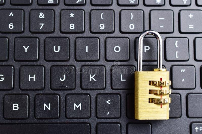 Lock on keyboard. Security lock on black computer keyboard , computer security concept royalty free stock photography