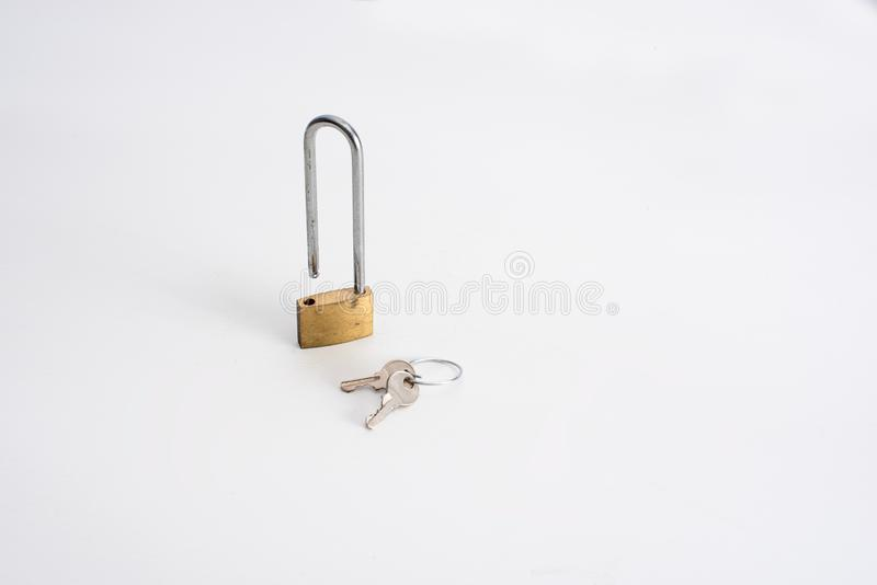 Lock and keys. Skinny padlock and set of two keys on white background. Access, business, close, concept, dkeys, element, entrance, keyhole, metal, object, open royalty free stock image