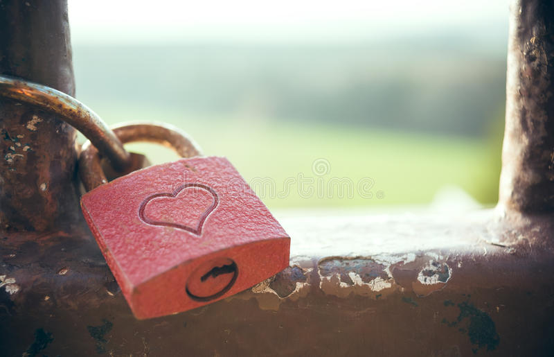 Lock love. A rusty lock love with a red heart stock photos