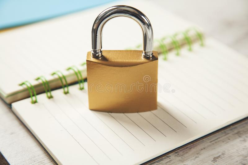 Lock on notepad. Lock on the notepad paper on the desk stock images