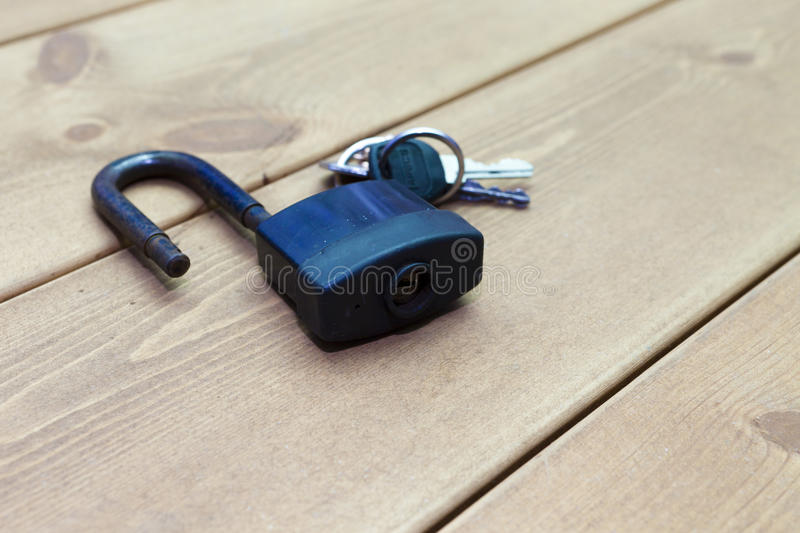 The lock on a table. Lies waiting for closing of doors stock photo