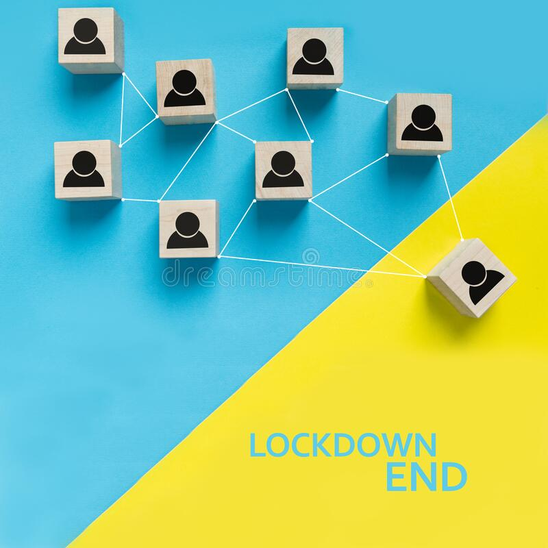 Lockdown end after Covid-19 on wooden blocks royalty free stock photography