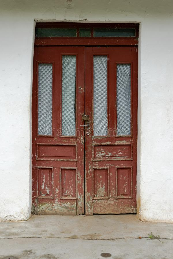 Locked country door. Crop view of abandoned house stock photography