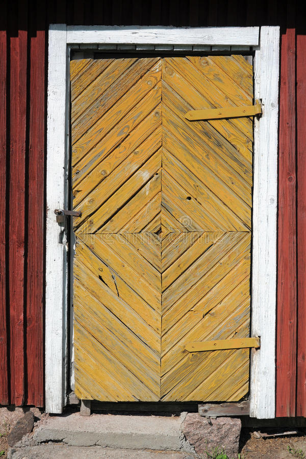 Locked door of old village house stock photo