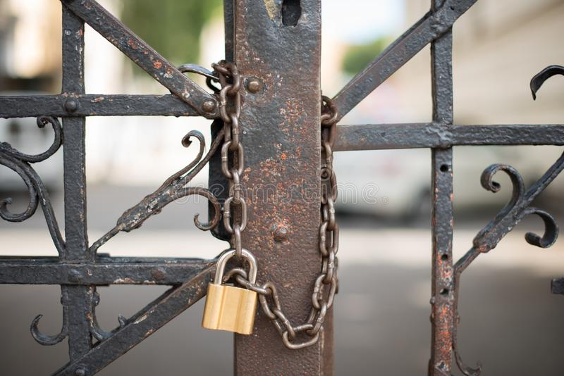 Locked doors with chain and golden lock royalty free stock image