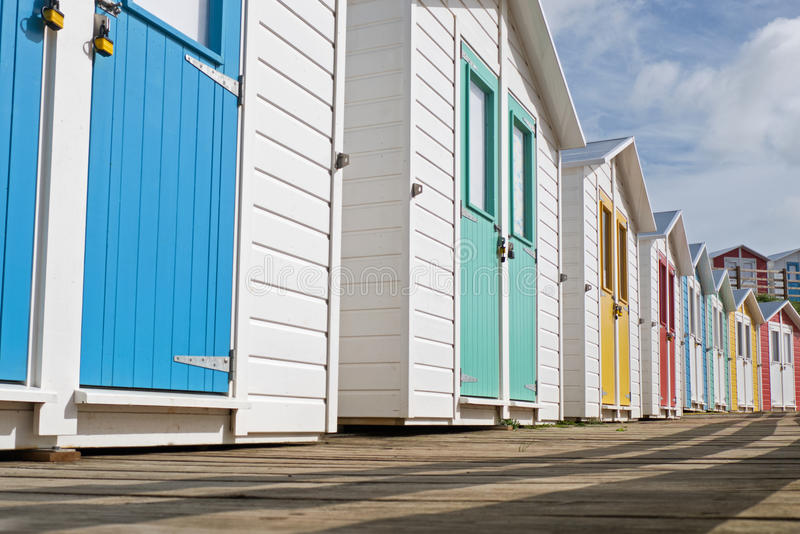 Locked English seaside chalets out of season. Row of traditionally built English seaside chalets locked up during the close season royalty free stock photos