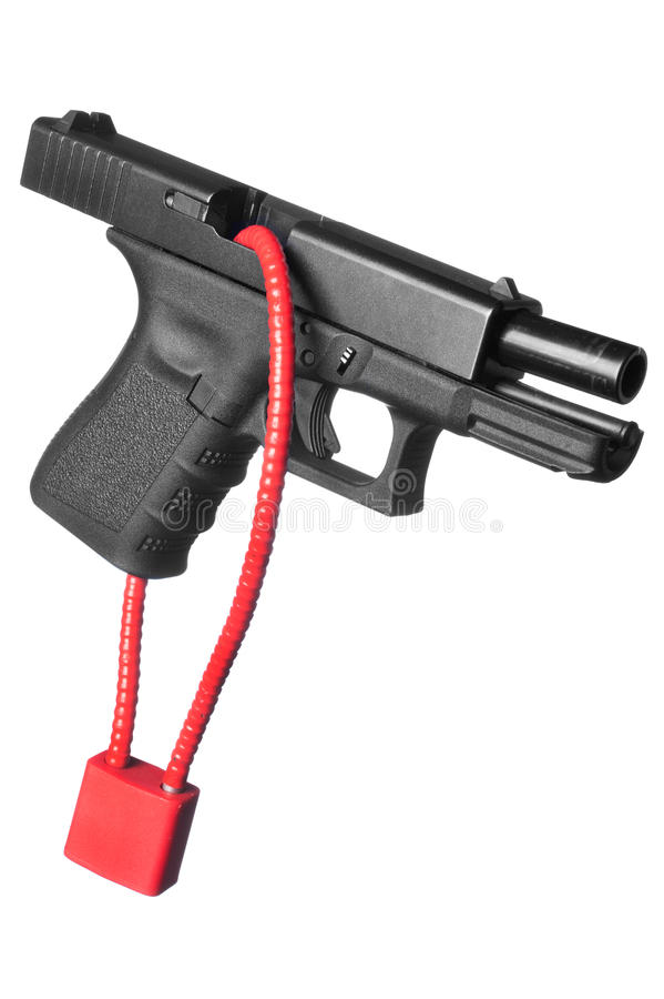 Locked firearm. A hand gun firearm is locked with a safety cable to prevent anyone from firing the weapon royalty free stock photos