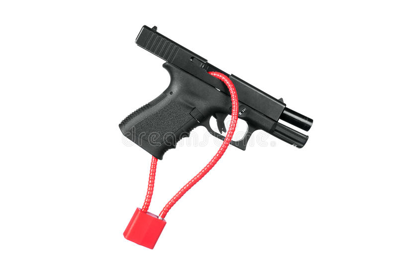 Locked firearm. A hand gun firearm is locked with a safety cable to prevent anyone from firing the weapon stock image