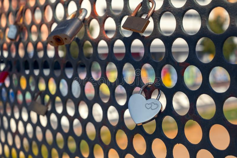 Locked heart shaped padlock on a bridge royalty free stock photos