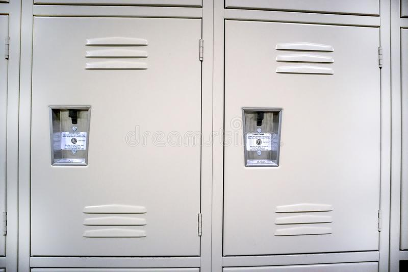 Metal Locker doors stand at the ready royalty free stock image