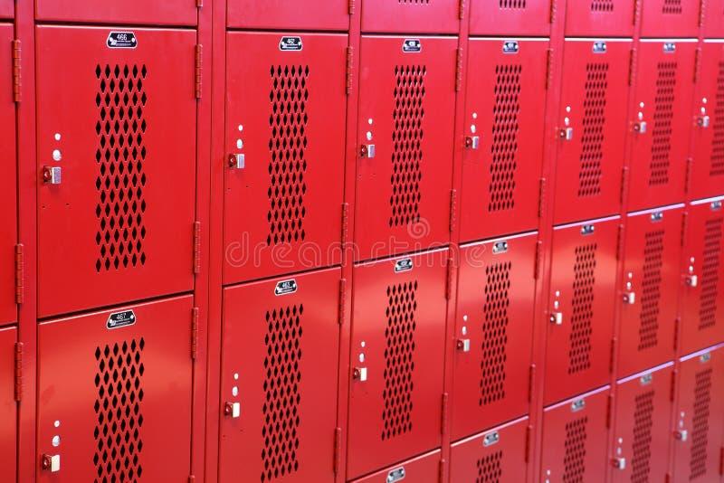 Metal lockers in a high school locker room. stock photos