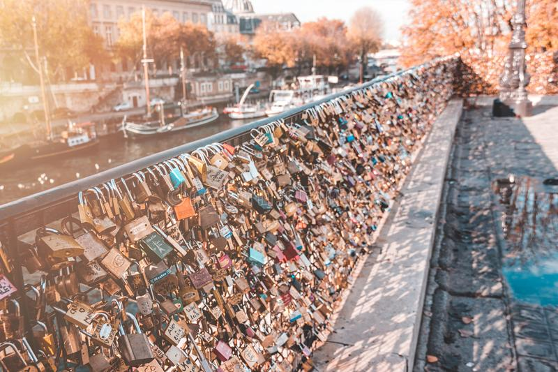 Lockers by the seine river in Paris, France on a sunny day. stock photography