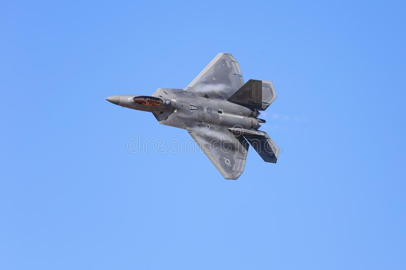 Lockheed Martin F-22 Raptor Jet Flying By. Lancaster, CA / USA - March 25, 2018: A United States Air Force F-22 Raptor stealth fighter jet flies by during an stock image