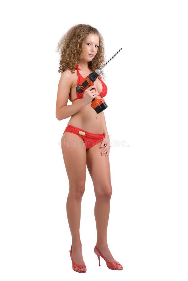 Lockiges Mädchenholding-Batteriebohrgerät mit Schneckenwelle stockbild