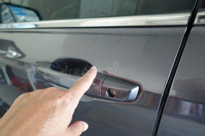 A woman Locking a car keyless stock images