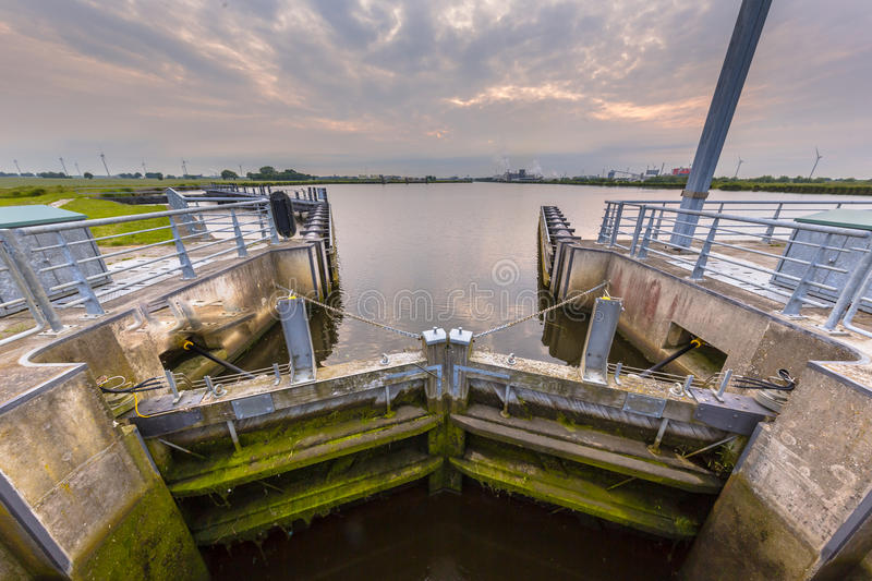 Locking chamber in a major waterway. These kind of facilities are one of the key elements in dutch water management stock images