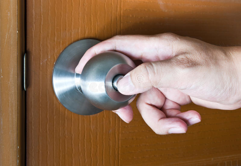 Locking door. Hand locking the door of his home royalty free stock images