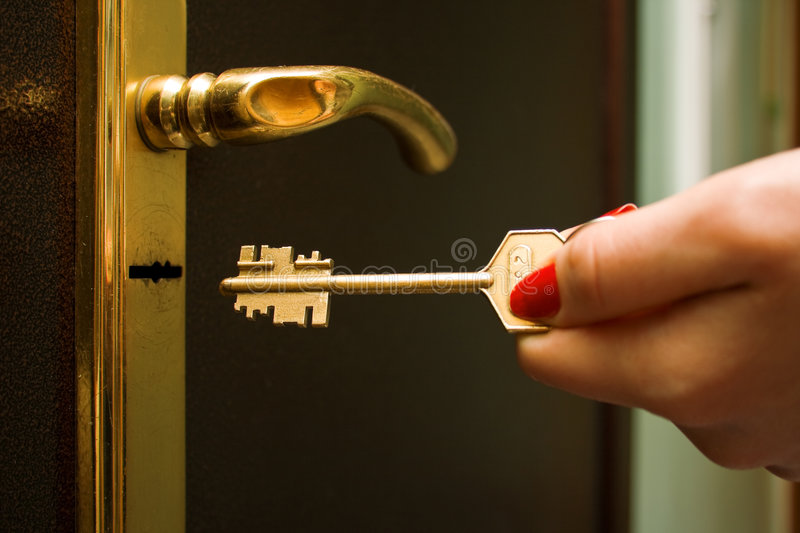 Locking a key stock photos