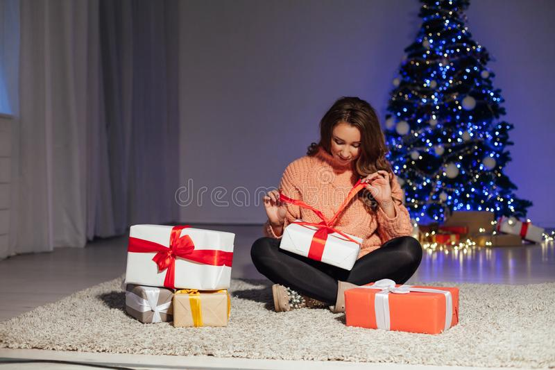 With locks at the Christmas tree with gifts for the new year lights garland royalty free stock images