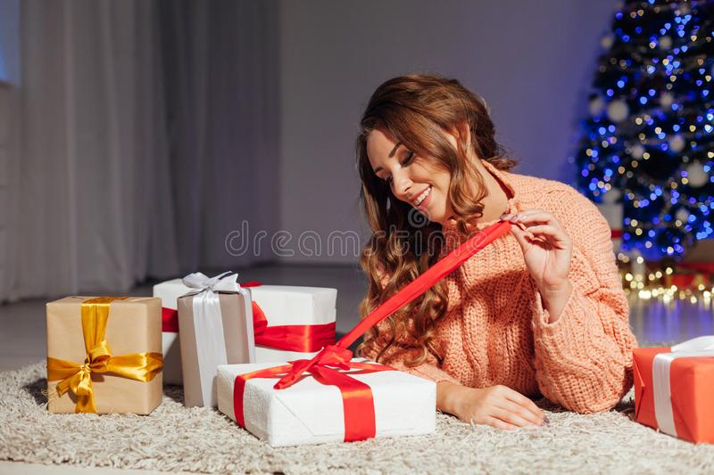 With locks at the Christmas tree with gifts for the new year lights garland stock photo
