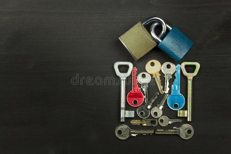 Locks and keys on a wooden table. New Symbol of love and happiness. Lock and heart. Key to the heart. Locked love. stock photo