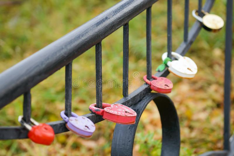 Locks with love hang on a metal fence stock image