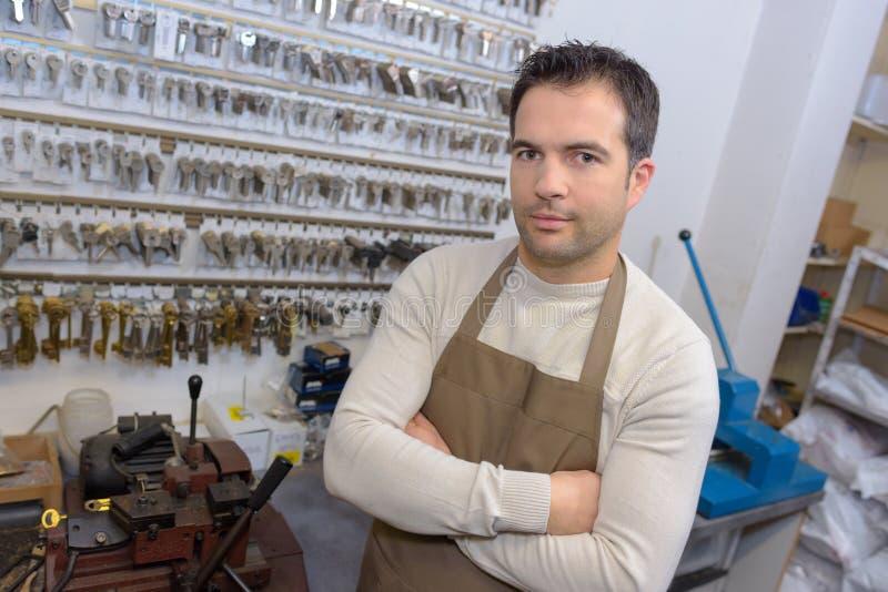 Locksmith in his shop. Locksmith royalty free stock image
