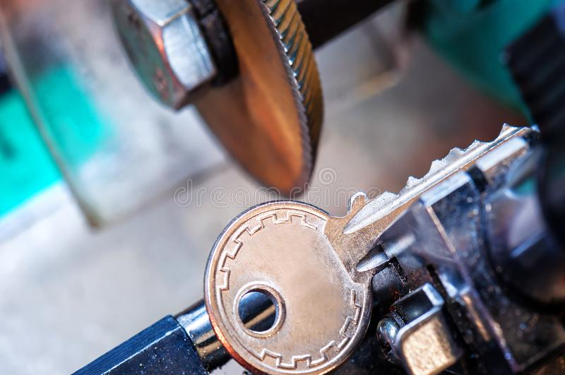 Locksmith, key duplication. Machine makes new copy stock photo