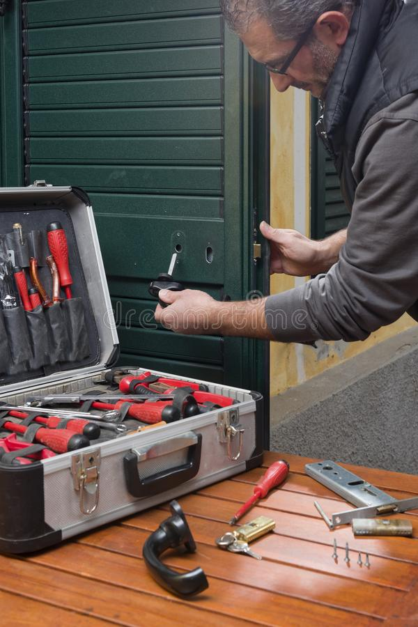 Locksmith repair the door lock stock photo