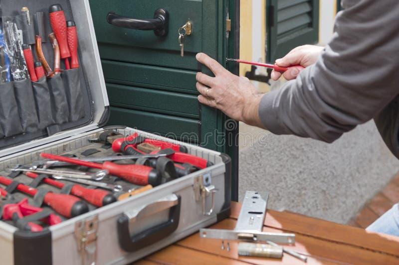 Locksmith repair the door lock royalty free stock photos